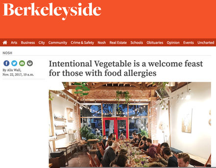 Berkeleyside intentional vegetable feast article with image of people sitting along table eating