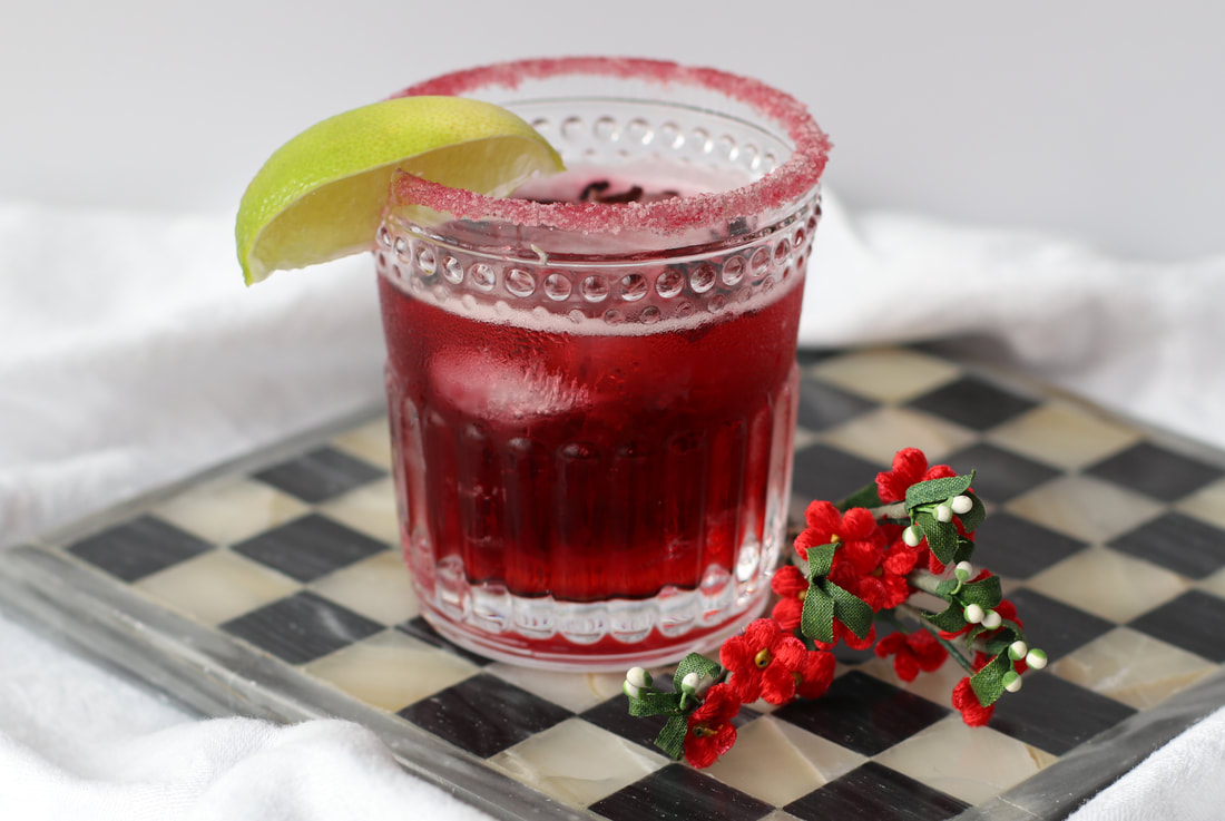 Hibiscus margarita with adaptogenic sugar rim from DIY cocktail kit